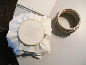 Embroidery hoops being prepared for the session.